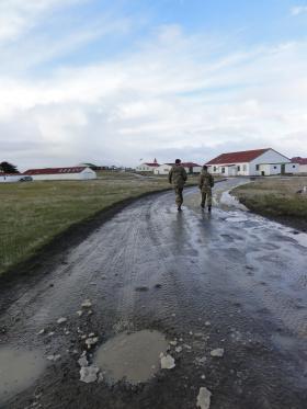 3 PARA CO and RSM walk through Goose Green settlement, 9 June 2012.