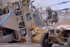 Cutting equipment being used on a Jackal vehicle, exercise at Camp Bastion, 2011