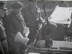 Field Marshal Montgomery, in a fetching pair of gloves, inspects an Airborne Jeep, c.1944