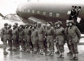 Members of 12th Para Bn form up by a Dakota aircraft, undated.