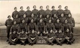 Group portrait of 9 Platoon, C Company, 2nd Battalion The Parachute Regiment, July 1944.