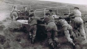 Members of 12th Para Bn push out a vehicle, undated.