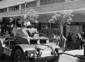 A Staghound of 3 King's Own Hussars on Kingsway during King's Birthday Parade, Haifa, Palestine, 1947