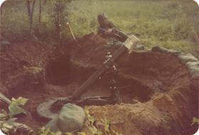 Pte Crichton of A Coy, 4 PARA Mortars beside the 4.2inch mortar pit on exercise in Minnesota, 1983