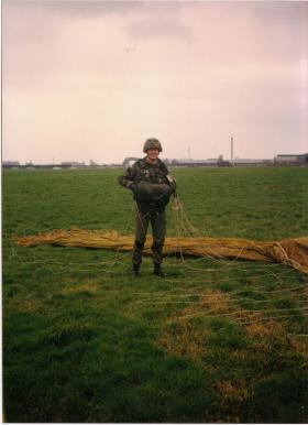 Paul Hennersey, of A Coy, 4 PARA, after a jump at Aintree Racecourse, 1980s