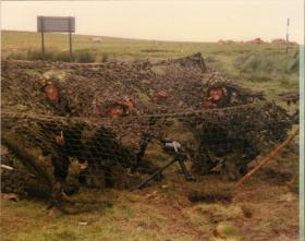 Men of A Coy, 4 PARA Mortars under a temporary shelter on exercise at Warcop Training Area, 1980s