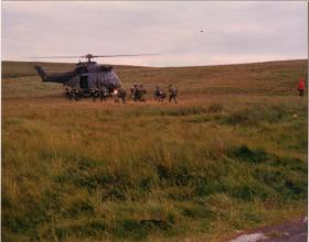 Members of A Coy, 4 PARA embark for a 'jolly jaunt' on a Puma, 1980s