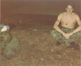 Pte Lee Crichton after making his first 'Basha' on exercise, 1980s