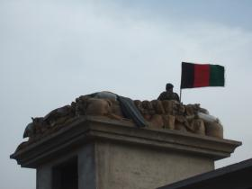 Soldier next to Afghan Flag