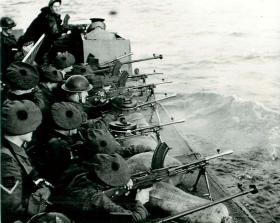 Troops train for the Bruneval raid by firing Bren guns and Boys from a landing craft, 1942.