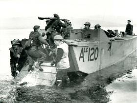 A posed Bruneval training shot of troops on board a landing craft.