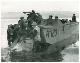 Troops re-embarking on landing craft.