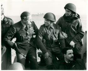 Squadron Leader PC Pickard talks to the men he dropped at Bruneval.