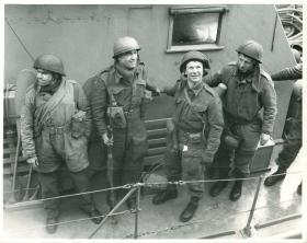 "Wearing ""P"" type helmets, four of the paratroopers who took part in the Bruneval raid, 1942."