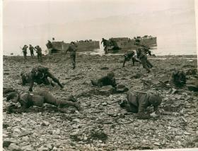 Troops securing the beach after landing.