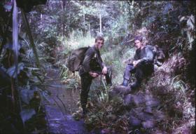 Rod Scott & Taffy Trott enroute from D Company, Gunnan Gadjit to B Company, Plaman Mapu, Borneo
