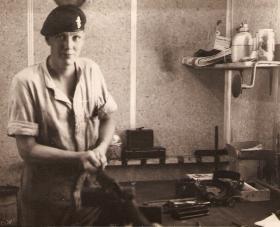 Jeff Chandler REME (att 2 PARA) at work on camp in Bahrain, 1963