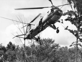 Belvedere helicopter dropping soldiers from Guards Para Coy into a patrol area, Malaya, 1968