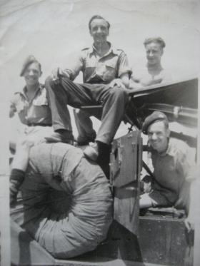 Soldiers relax with a scout car, Palestine, 1946