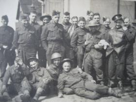 Group portrait of 70th Battalion, Royal East Kent Regiment 'The Buffs', relaxing at RAF Manston, 1941