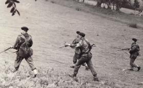 Soldiers advance during Brecon Battle Camp, 1961