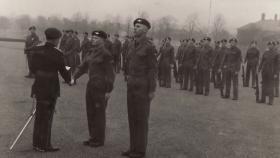 Brig Crookenden congratulates champion recruit at passing out parade