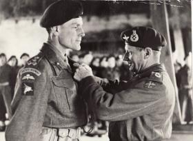 Brigadier Hill receiving award from Field Marshal Montgomery
