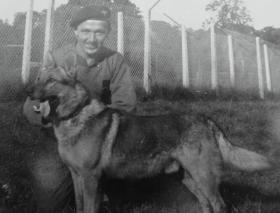 Cpl Walton with a Para dog, probably near Wismar, 1945.