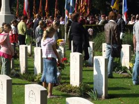 Dutch children place flowers on the graves of British paratroopers.