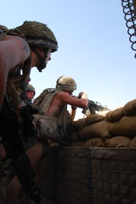 Paras man their firing position to repel a camp attack on FOB Gibraltar, Afghanistan, 2008.