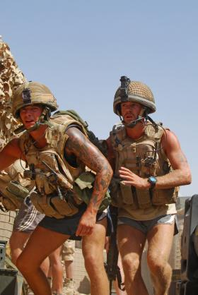 Paras rush to their firing positions during a camp attack, FOB Gilbraltar, Afghanistan, 2008