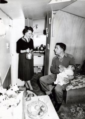 Family in caravan in Pegasus Village, Aldershot, 1960