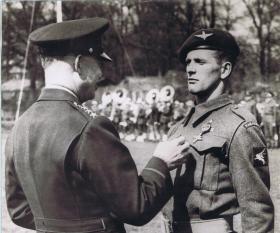 Gen Eisenhower awarding Distinguised Service Cross to CSM Reginald Allen, 1943