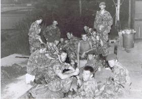 Group photo of C Coy 'Marauders' resting before a night patrol, Hong Kong, 1980