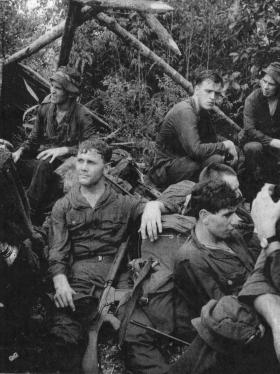 Guards Para Coy members rest during the long march to Ipho Training Camps, Malaya, 1964.