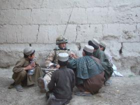 Member of 3 PARA spending time with local children in Afghanistan, 2008