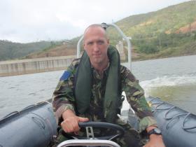 CSgt Phil Stout piloting a inshore boat, Belize