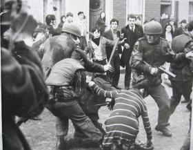 'Snatch Squad' at work during a riot. The soldier on the right is carrying a riot gun.