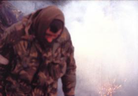 Bill Bentley MM almost obscured by smoke, Darwin Hill, Falklands, 1982.
