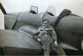 Len Green, Ground Engineer RAFVR, leaning on a Miles Magister used to train glider pilots at No 16 EFTS Burnaston.