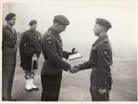 Lt Col Alistair Pearson presenting an award