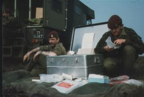 Cpl Joblin and Pte Lockren replenish medical supplies at the Isle of Man Dolby DZ, April 1984