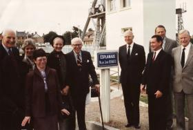 Major John Howard stands with veterans in Normandy, 1982