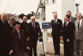 Major John Howard stands with veterans in Normandy, 1982