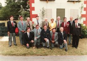 Group photograph of veterans, including Major John Howard, Normandy 1982