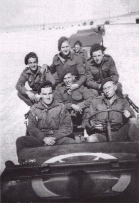 Men of 716 Lt Comp Coy RASC onboard an American jeep on convoy duty, near Egyptian border, Palestine