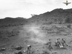 Gun crew from C Troop, 33 Para Light Regiment RA fire 75mm Howitzer, Radfan, 1957.