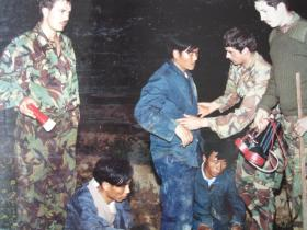 Men of C Coy 1 PARA with illegal immigrants caught at the border with China, Hong Kong, 1980