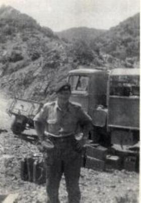 Cpl Les Banks with a supply truck in the Cyprus mountains, 1956