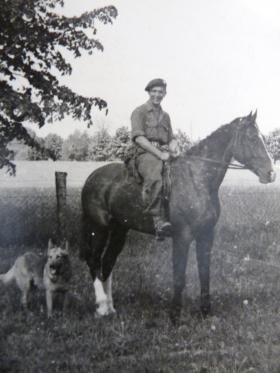 Aaron B Walton on horseback with a Para dog, probably in Germany, 1945.